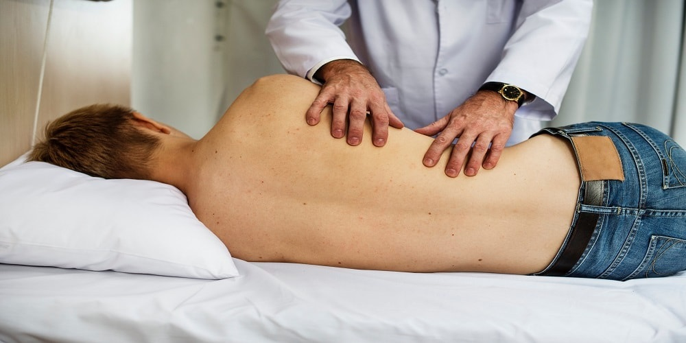 Man receiving chiropractic care on his side