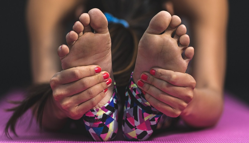 Close up of woman's feet while stretching