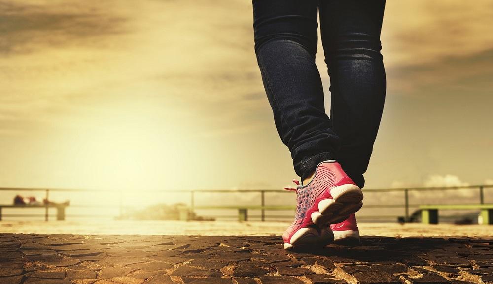 Person wearing red sneakers walking