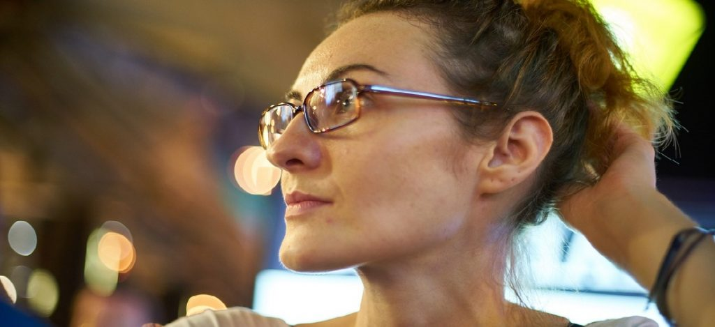Woman with glasses looking off to the side