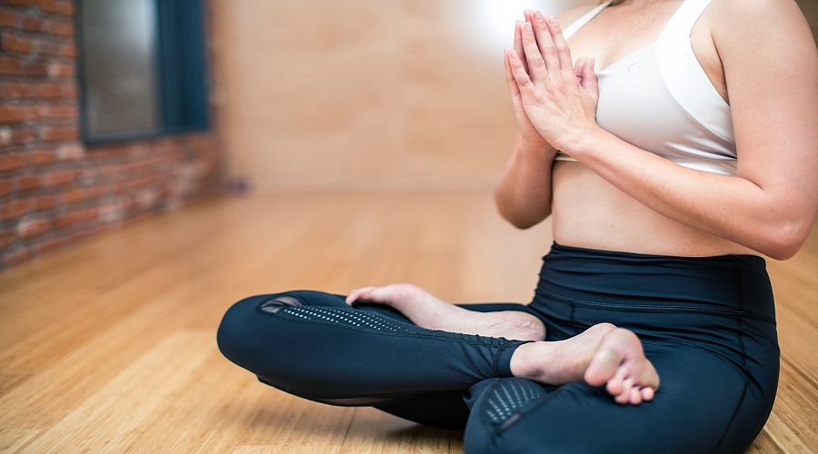 Woman doing yoga with legs crossed